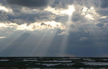 Storm Clouds with Light Shining through Over Lake Michigan