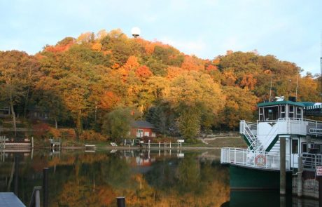 Star of Saugatuck in Dock with Fall Colors on Mount Baldhead across the Kalmazoo RIver