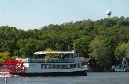 Star of Saugatuck Paddling past Mt. Baldhead on the Kalamazoo River